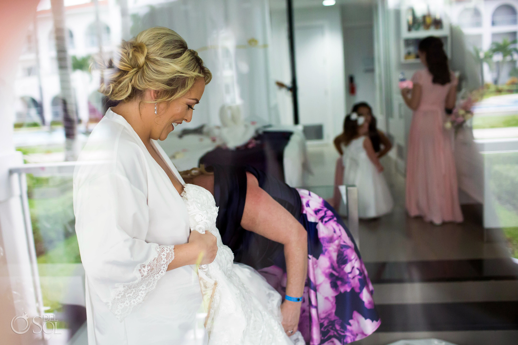 Bride Getting Ready with the wedding party and family Riu Palace Mexico Suit