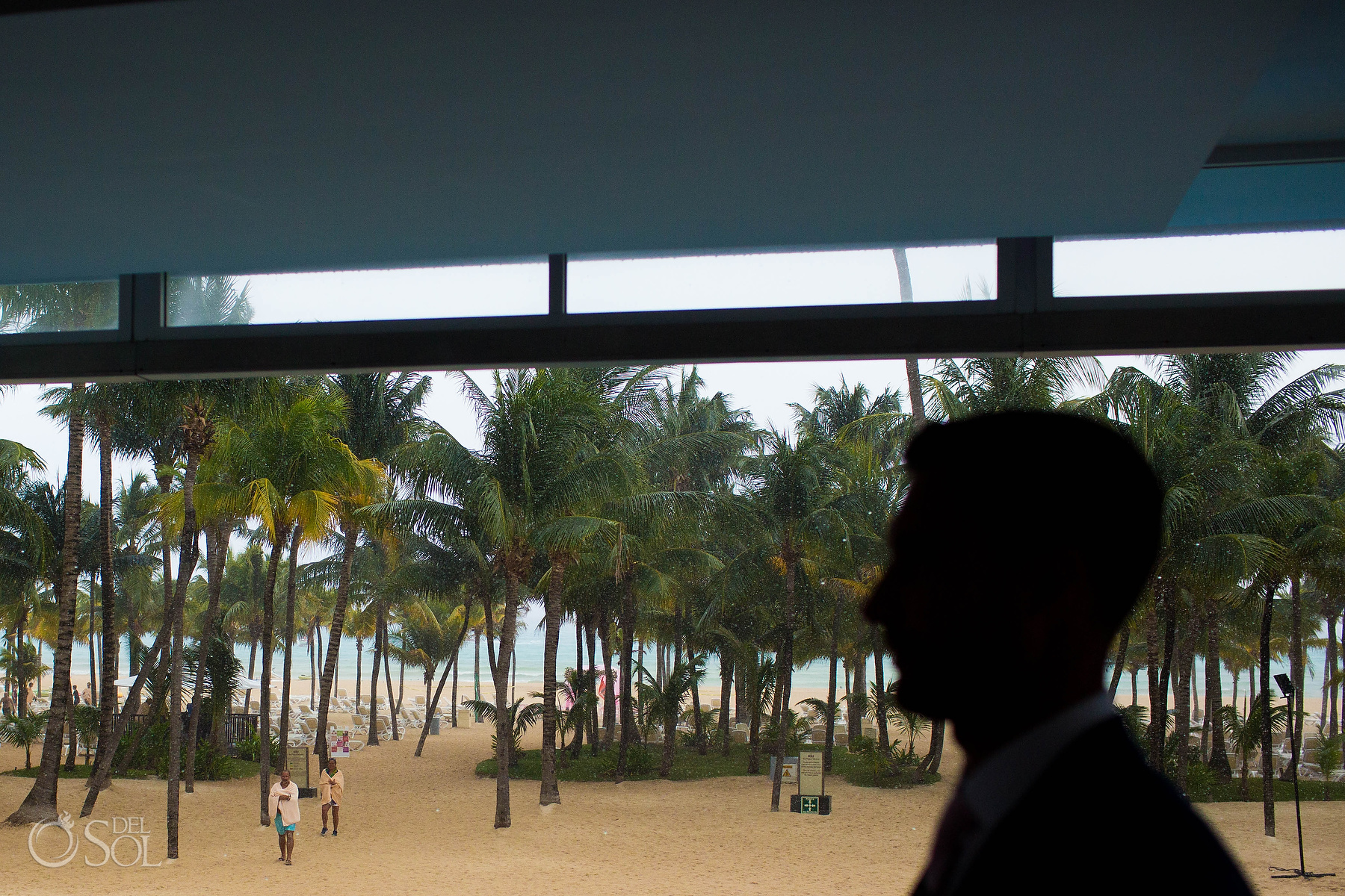 raining on wedding day Groom silhouette at the Riu Palace Mexico photographer
