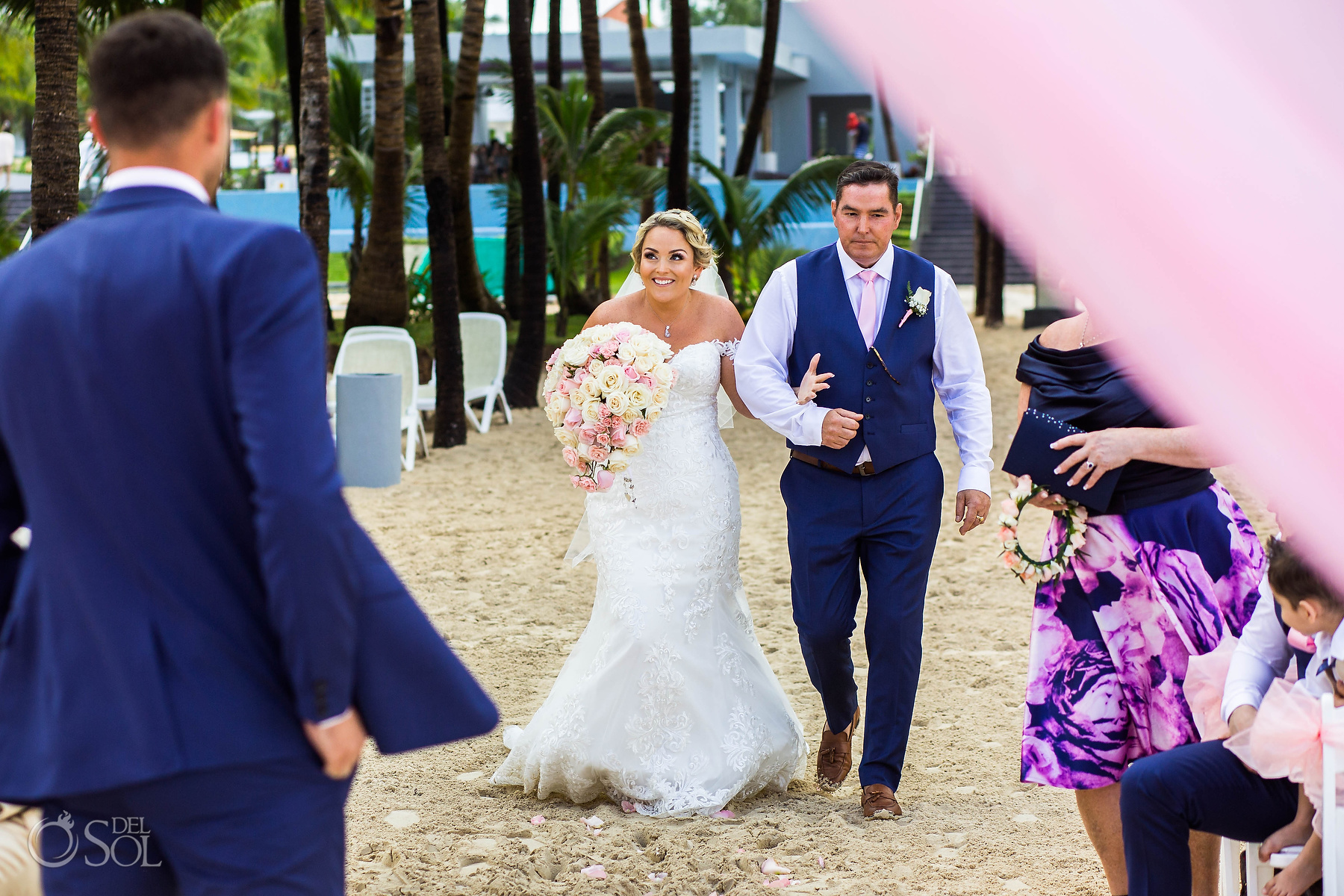 Bride groom First look walking with dad on the beach