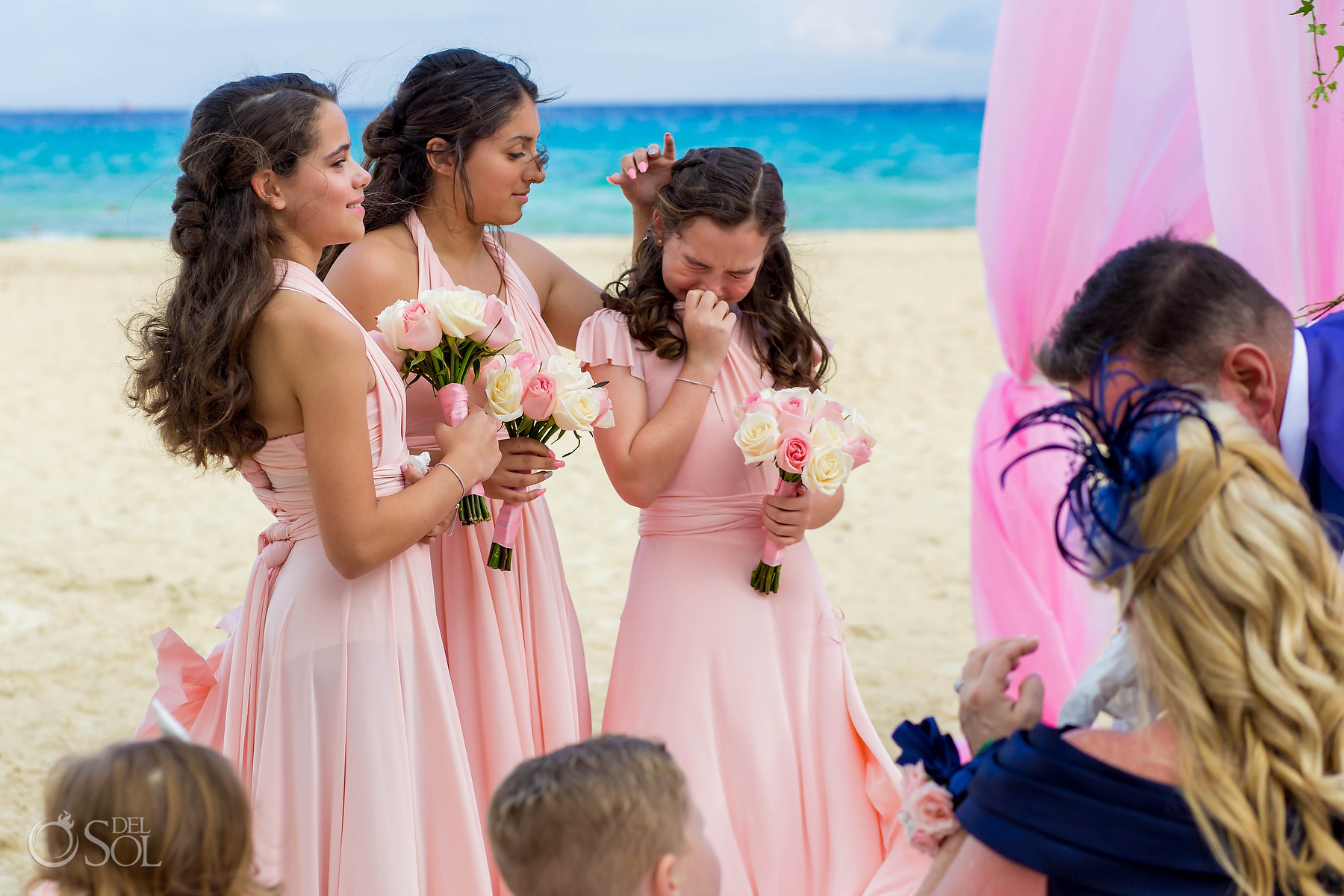 Brides daughter wedding party crying at ceremony Riu Palace Mexico wedding photographer