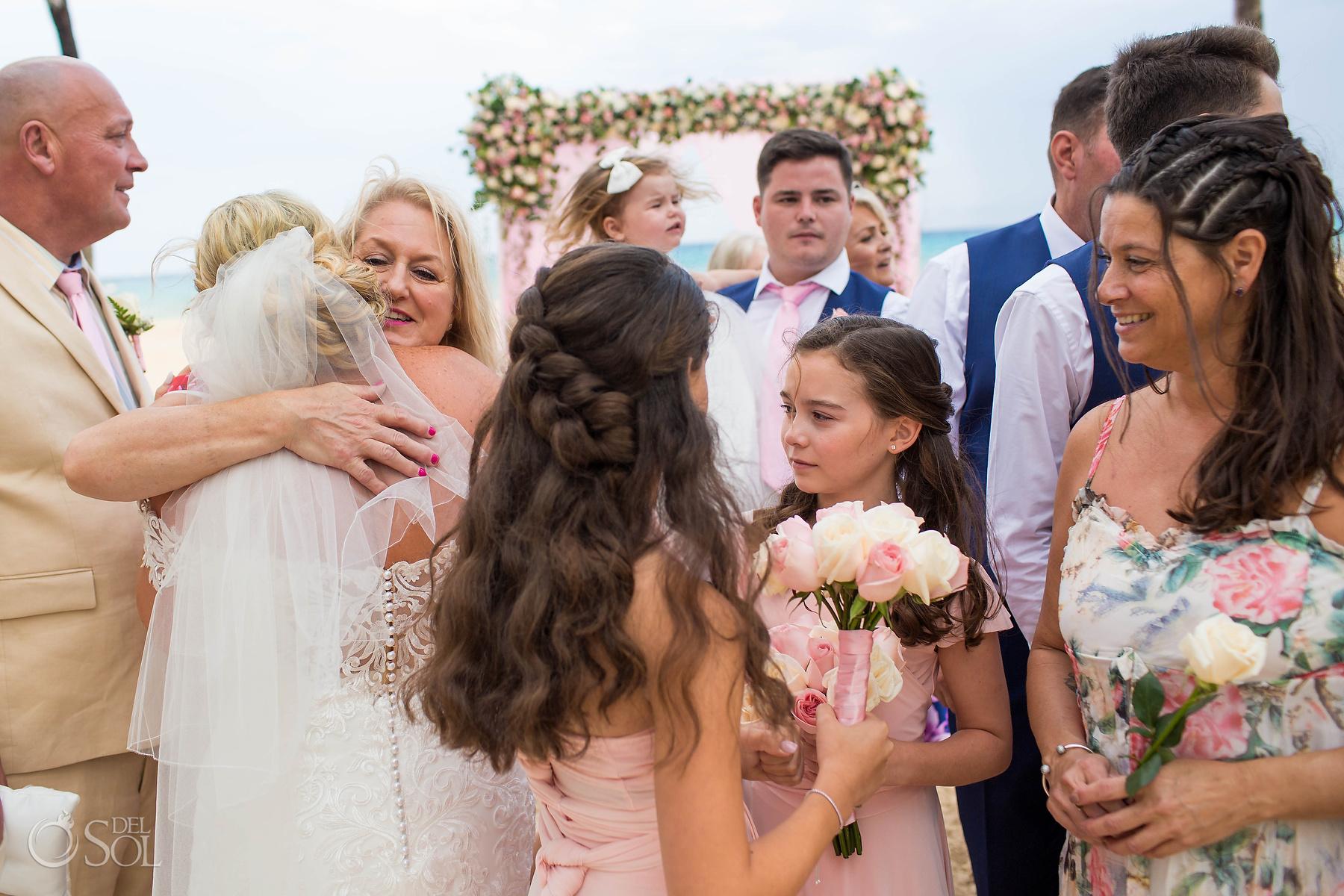 Family congrats hugs wedding ceremony