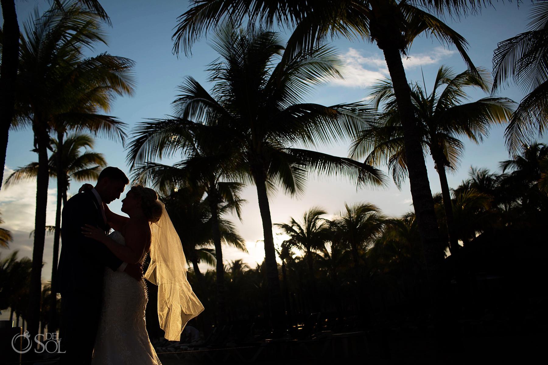 Bride and Groom Silhouette flirt light veil Riu Palace Mexico Palms