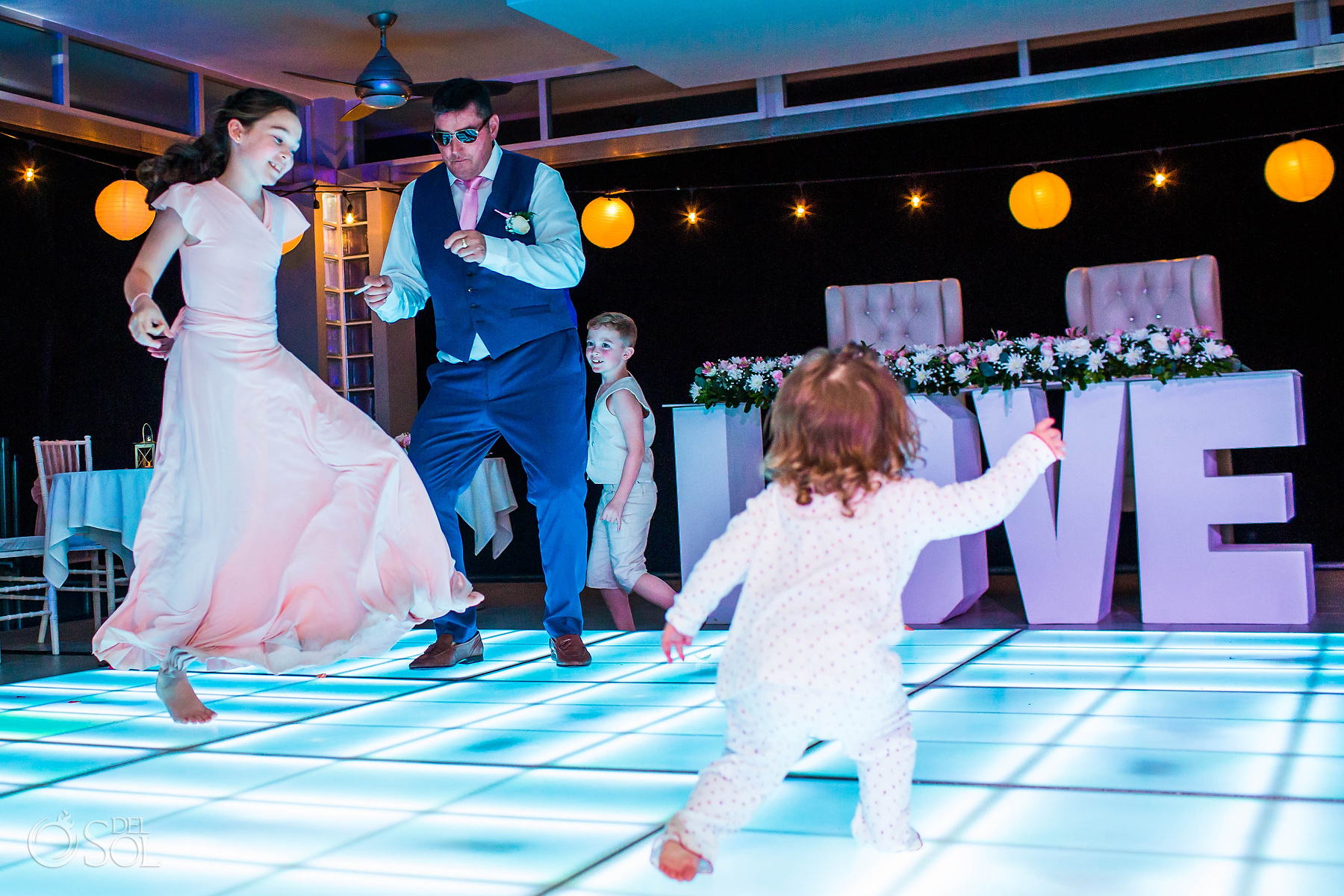 kids dancing at led dance floor Riu Palace Mexico Wedding Photographer