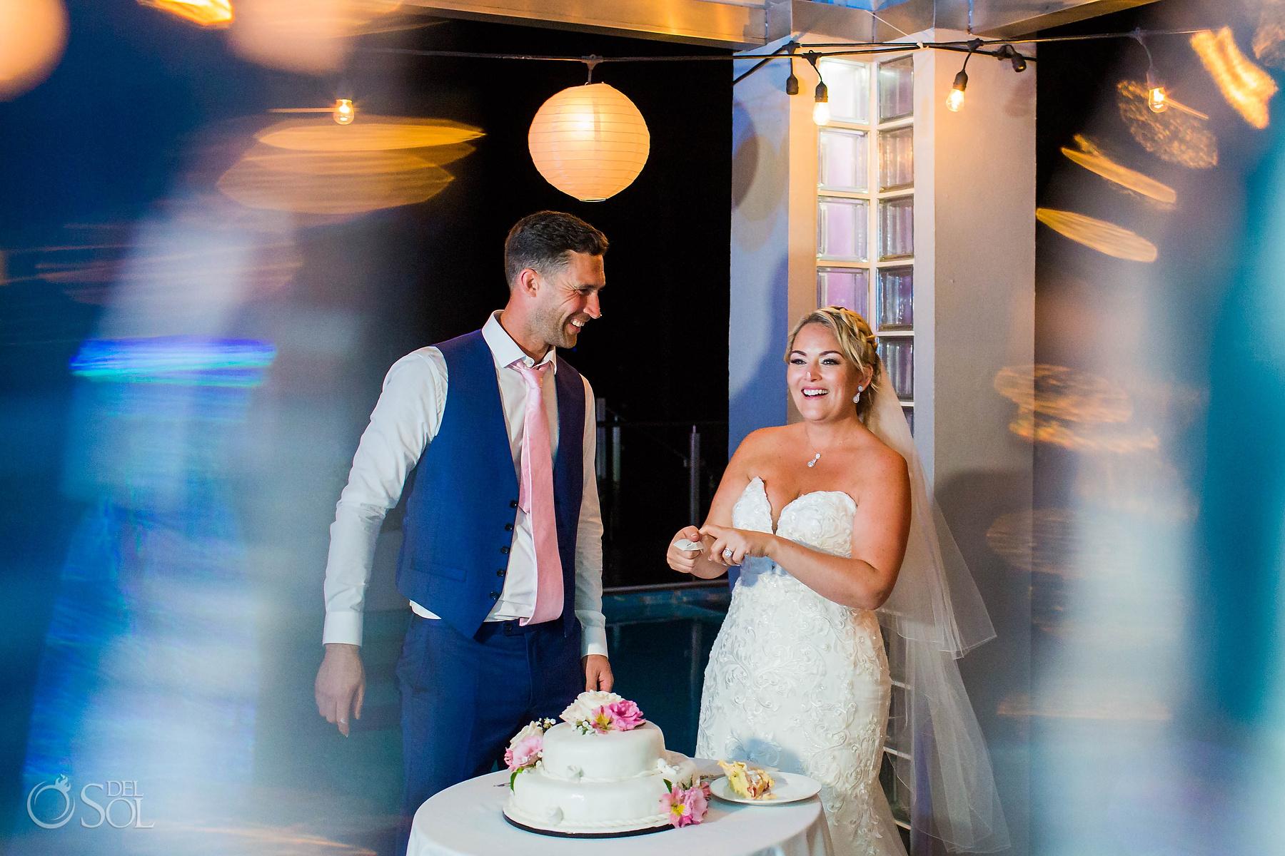 having fun Cutting the cake Riu Palace Wedding photographer