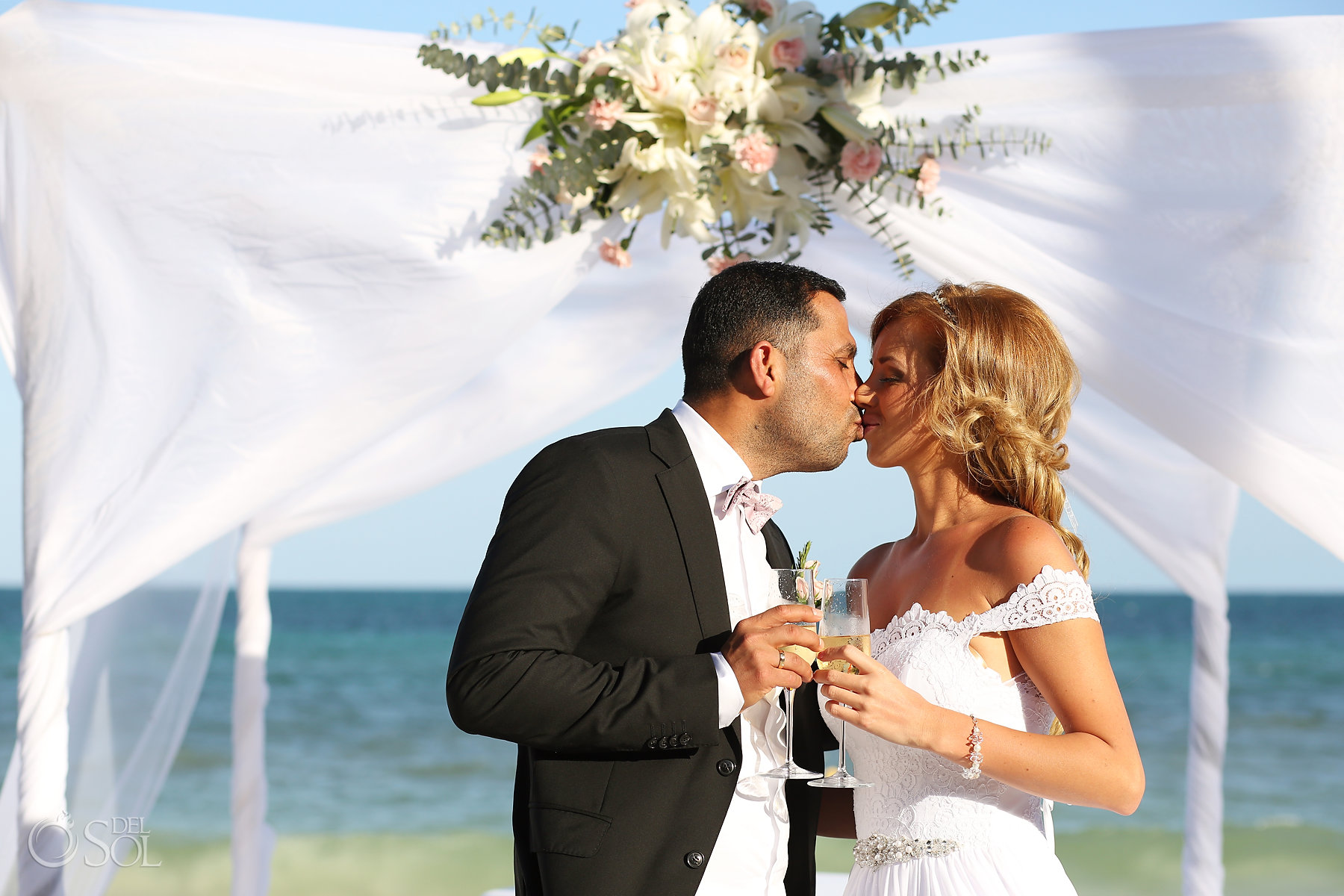 just married kiss with champagne Best Elopement Locations Mexico