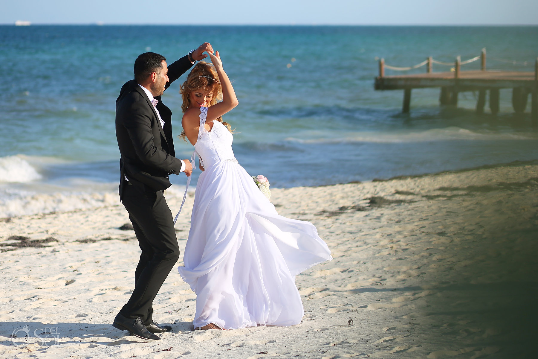 Groom and Bride dancing at the beach Best Elopement Locations Mexico