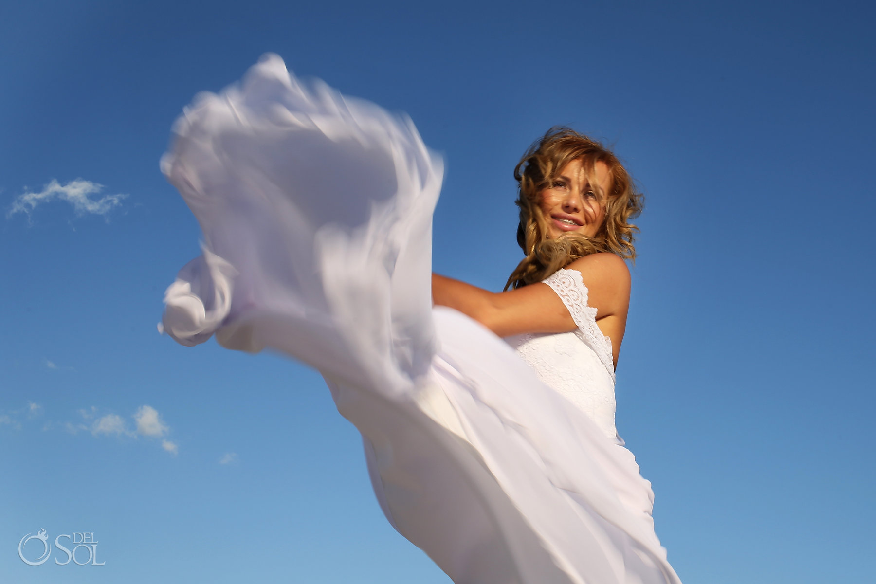 Polish Bridal Photoshoot Playing with her light dress