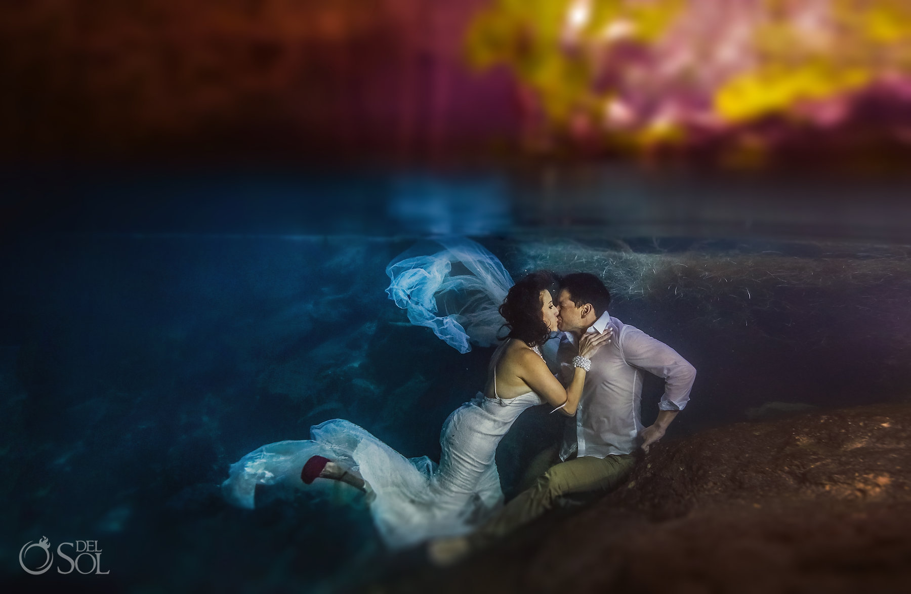 Underwater cenote Superman Photographer trash the dress
