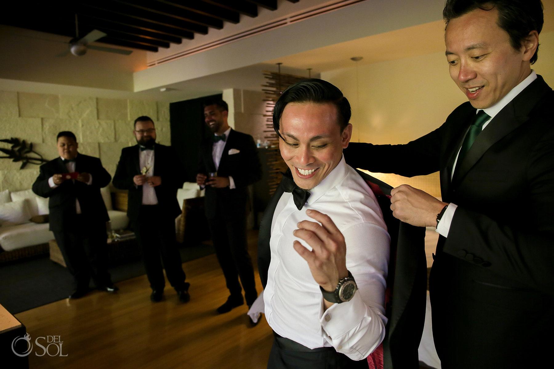groom getting ready putting tuxedo on Blue Diamond Luxury Boutique Hotel