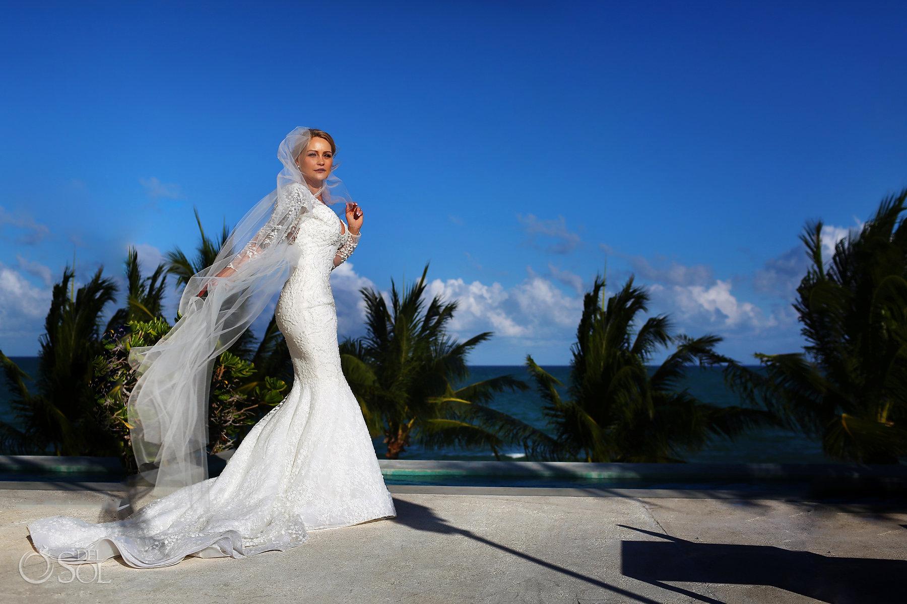 bride wearing Adrianna Papell wedding dress long bridal veil blue diamond luxury boutique hotel