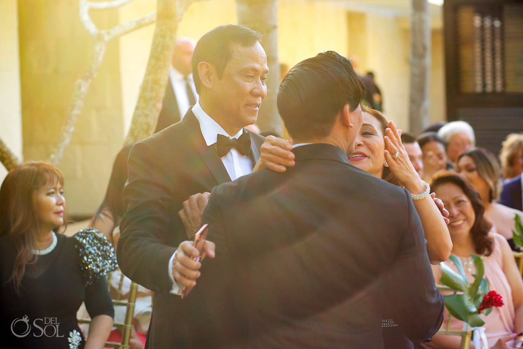 Family Love groom hugs mom and dad blue diamond luxury boutique hotel