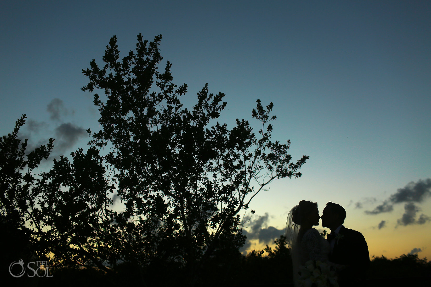 sunset silhouette destination wedding bride and groom portrait blue diamond luxury boutique hotel
