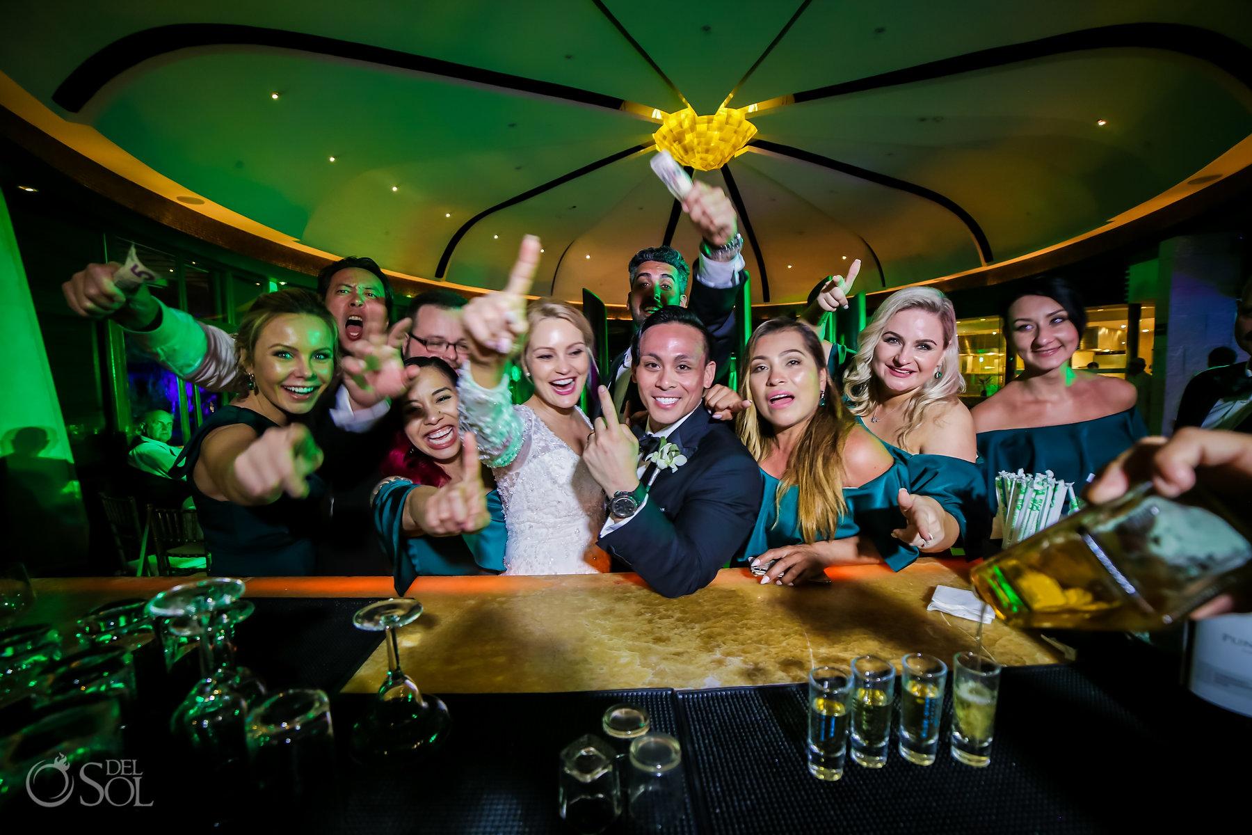 fun bridal party photo idea ordering tequila shots Restaurant Ambar blue diamond luxury boutique hotel