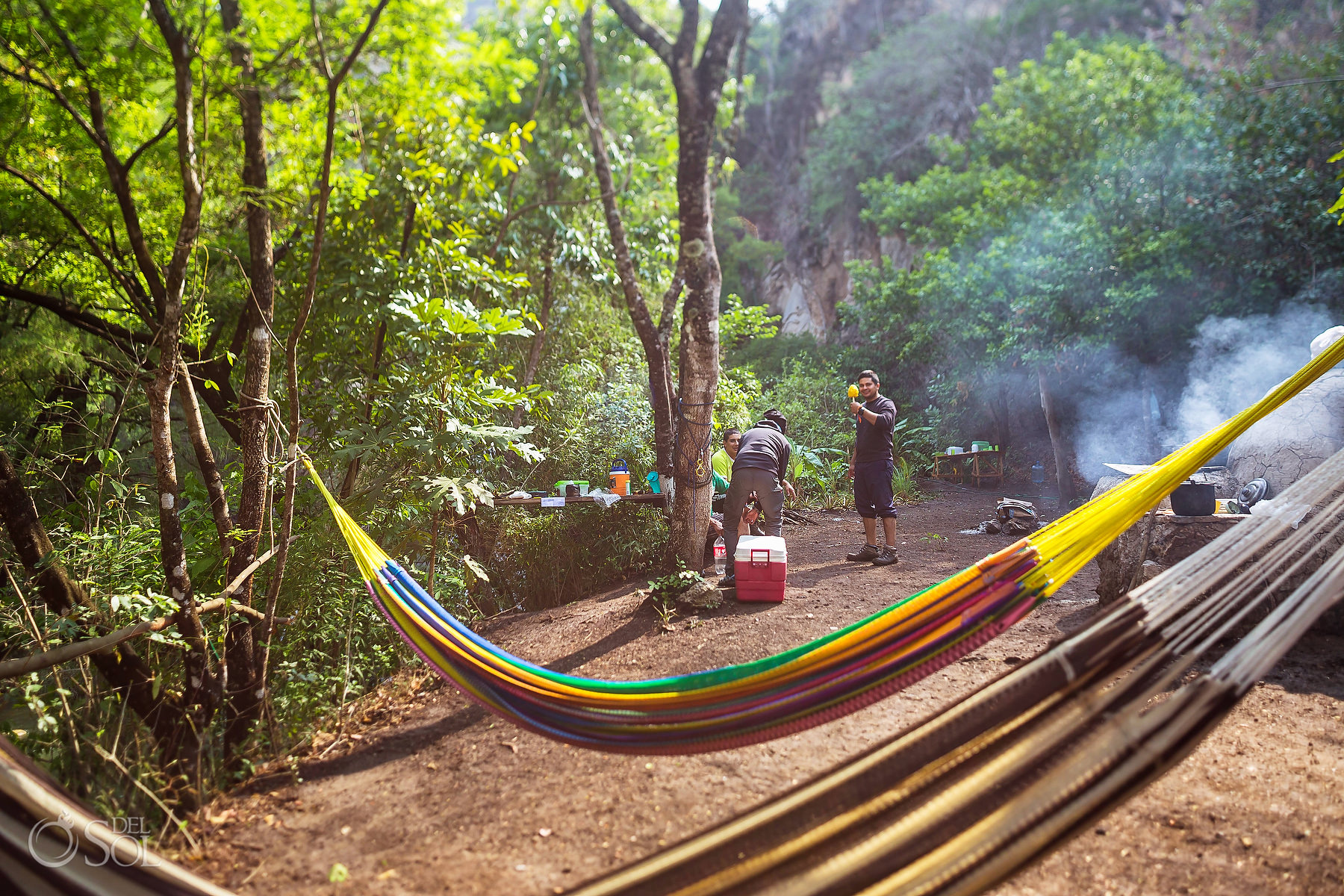 hammocks hanging across campsite Chiapas waterfall adventure