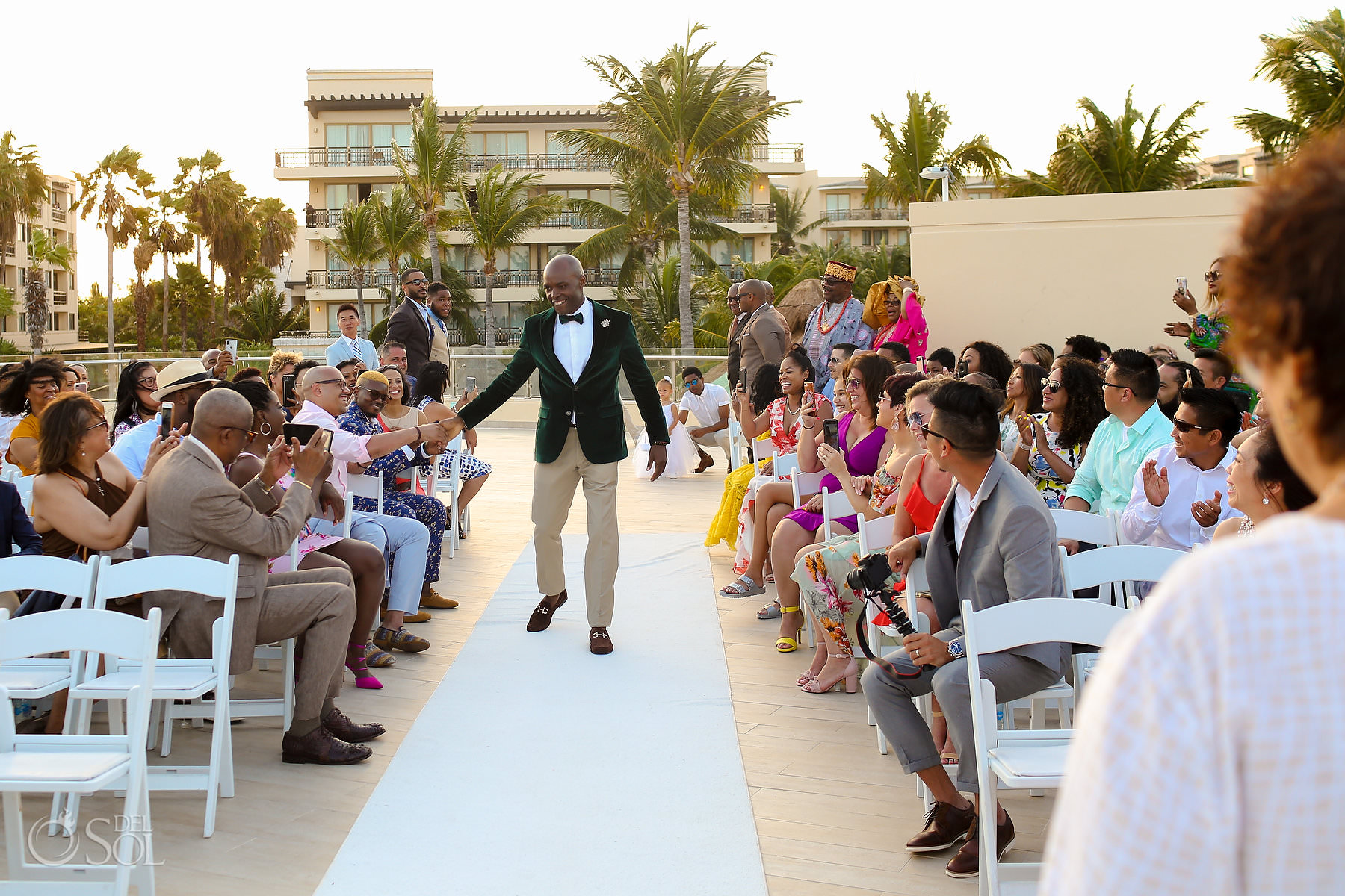Best groom wedding entrance ideas high five Dreams Riviera Cancun terrace Mexico