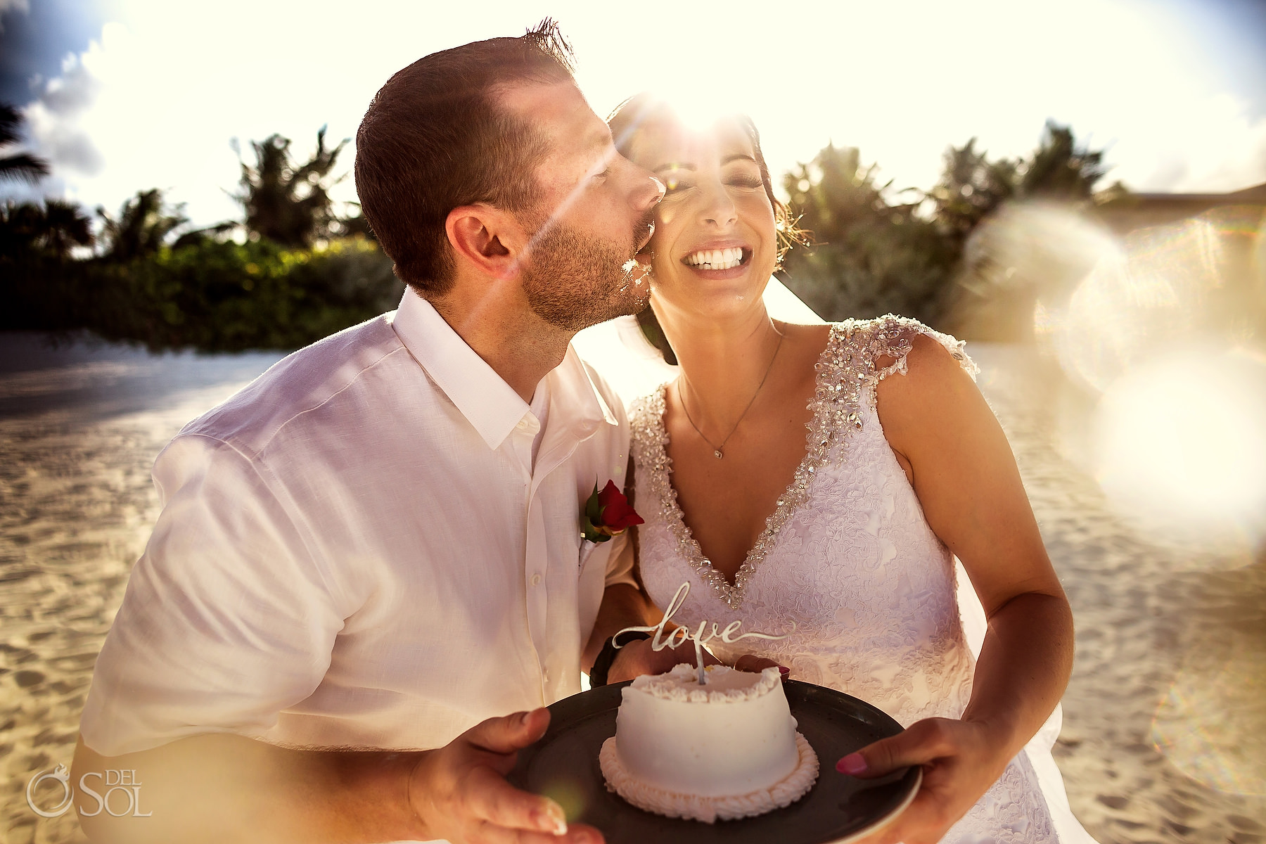 bride and groom celebrating intimate elopement Secrets Maroma Mexico
