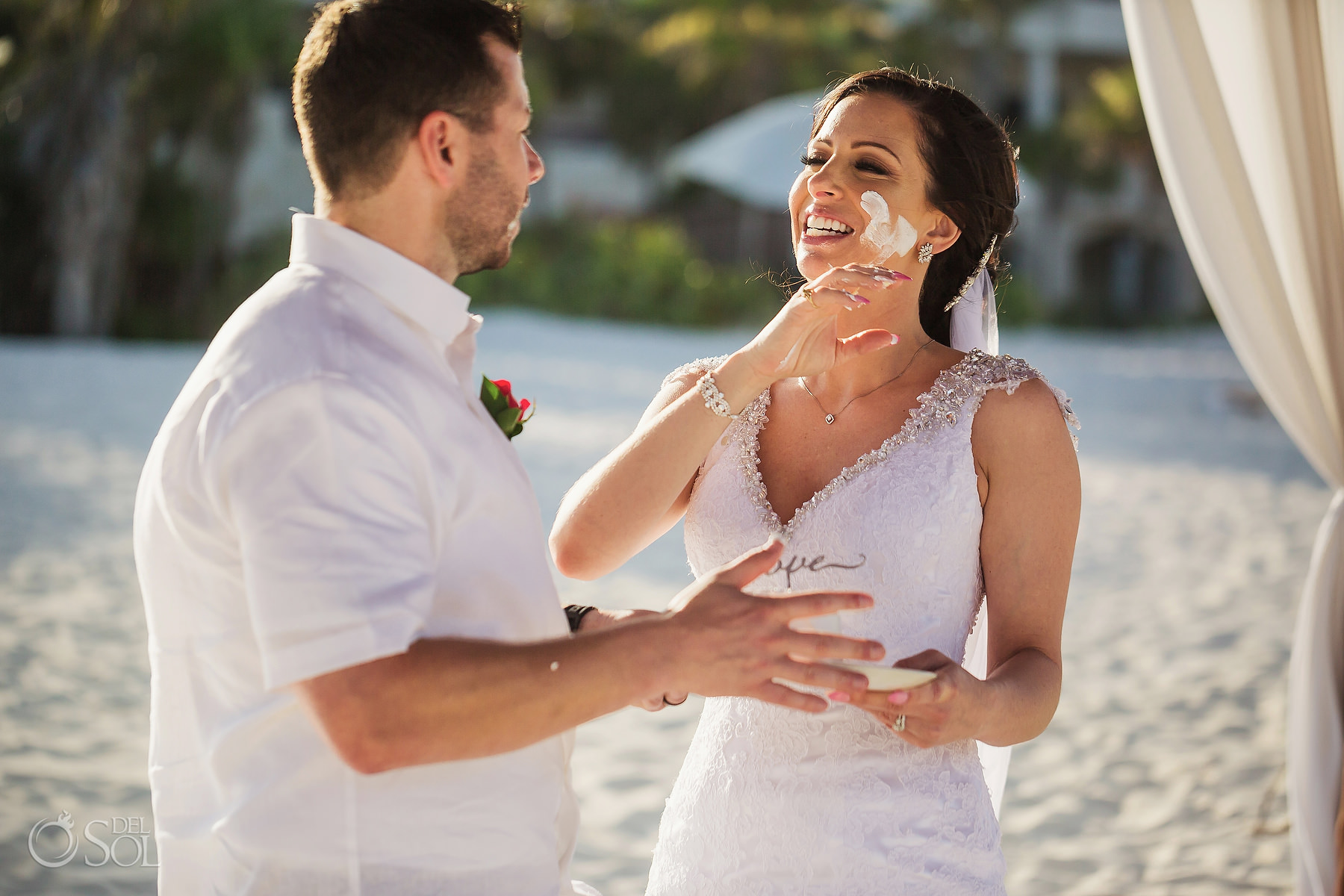 bride and groom fun cake cutting Secrets Maroma Elopement
