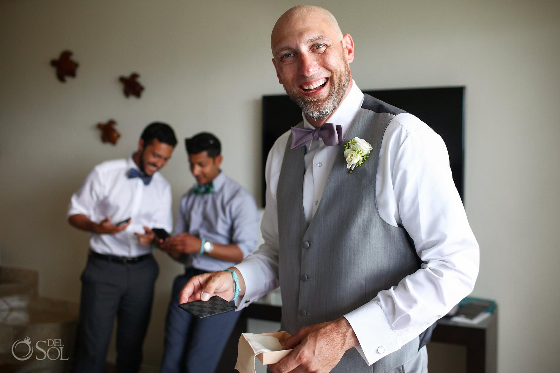 groom opening wedding day gifts Louis Vuitton wallet Akumal Bay Beach and Wellness Resort Wedding