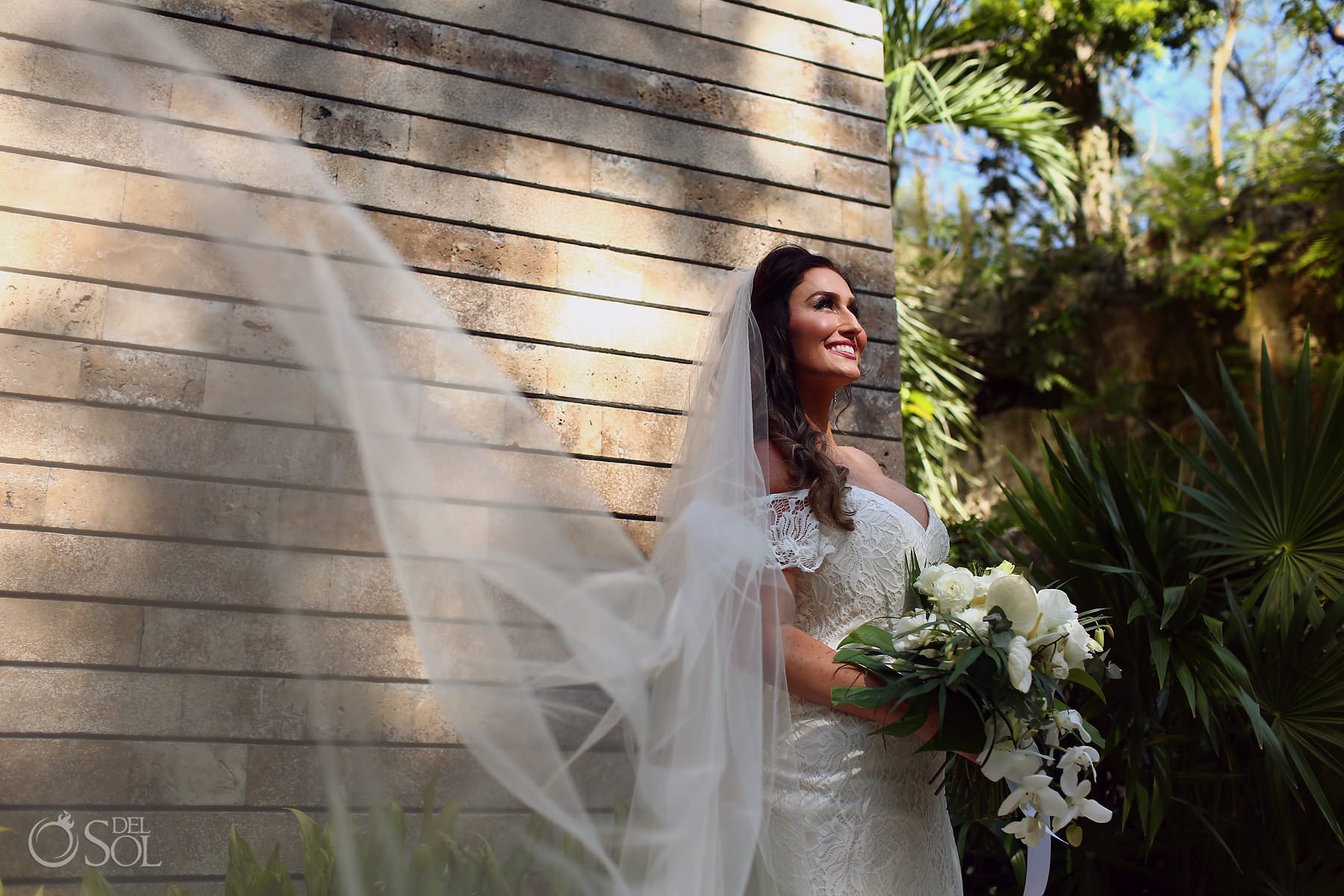 bride wearing boho chic Lillian West wedding dress Xcaret Resort Playa del Carmen Mexico