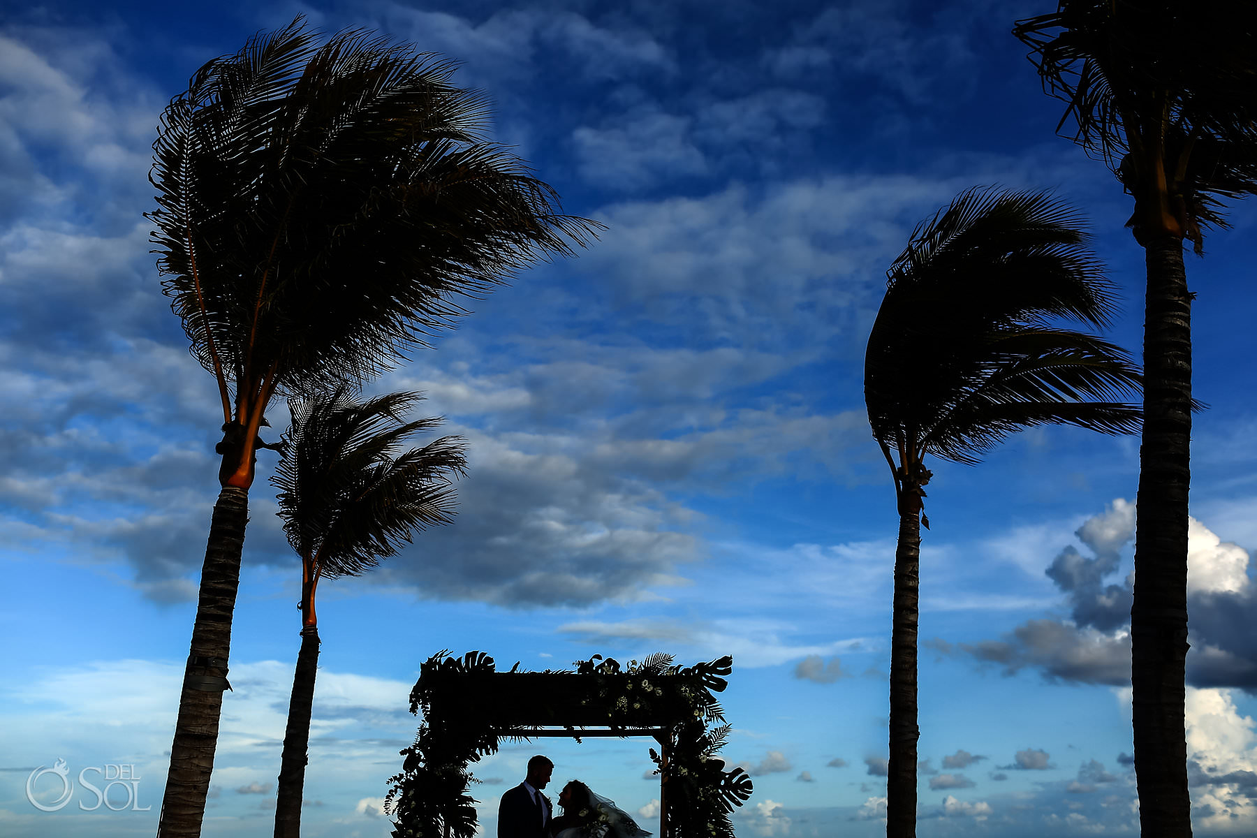 Artistic silhouette beach wedding ceremony Hotel Xcaret Playa del Carmen