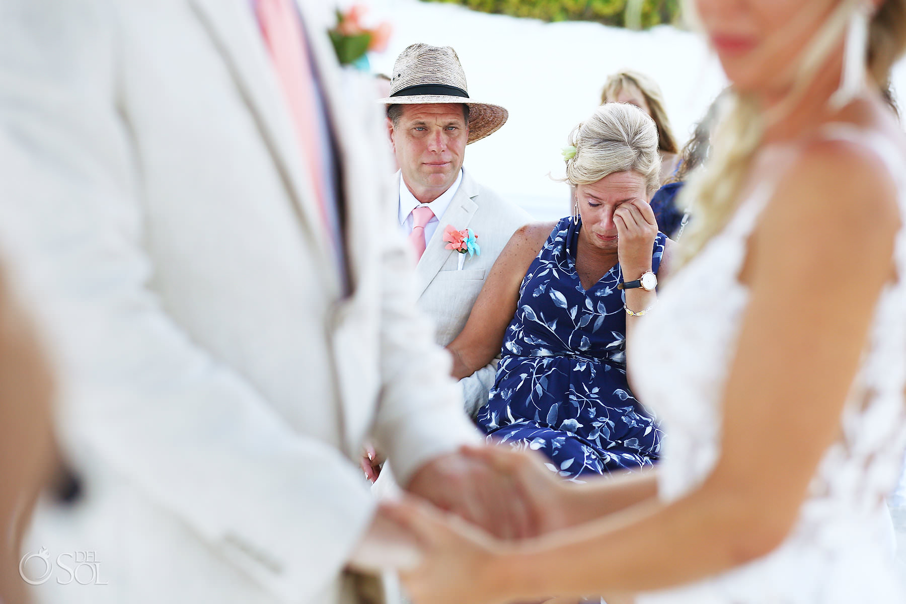 emotional parents at wedding ceremony