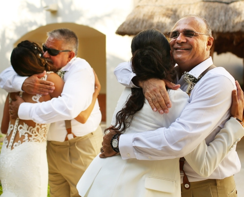 Brides first look with their fathers Same Sex Wedding at Secrets Maroma