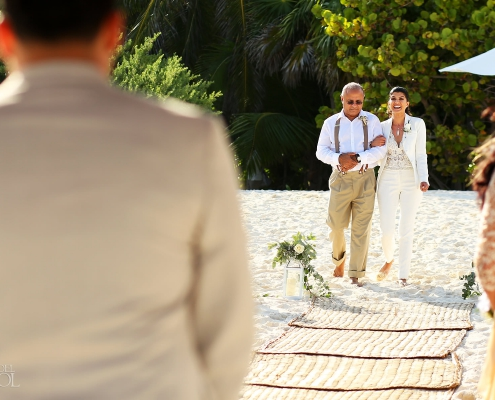 Bride walking down the aisle Mexico Same Sex Wedding Secrets Maroma beach