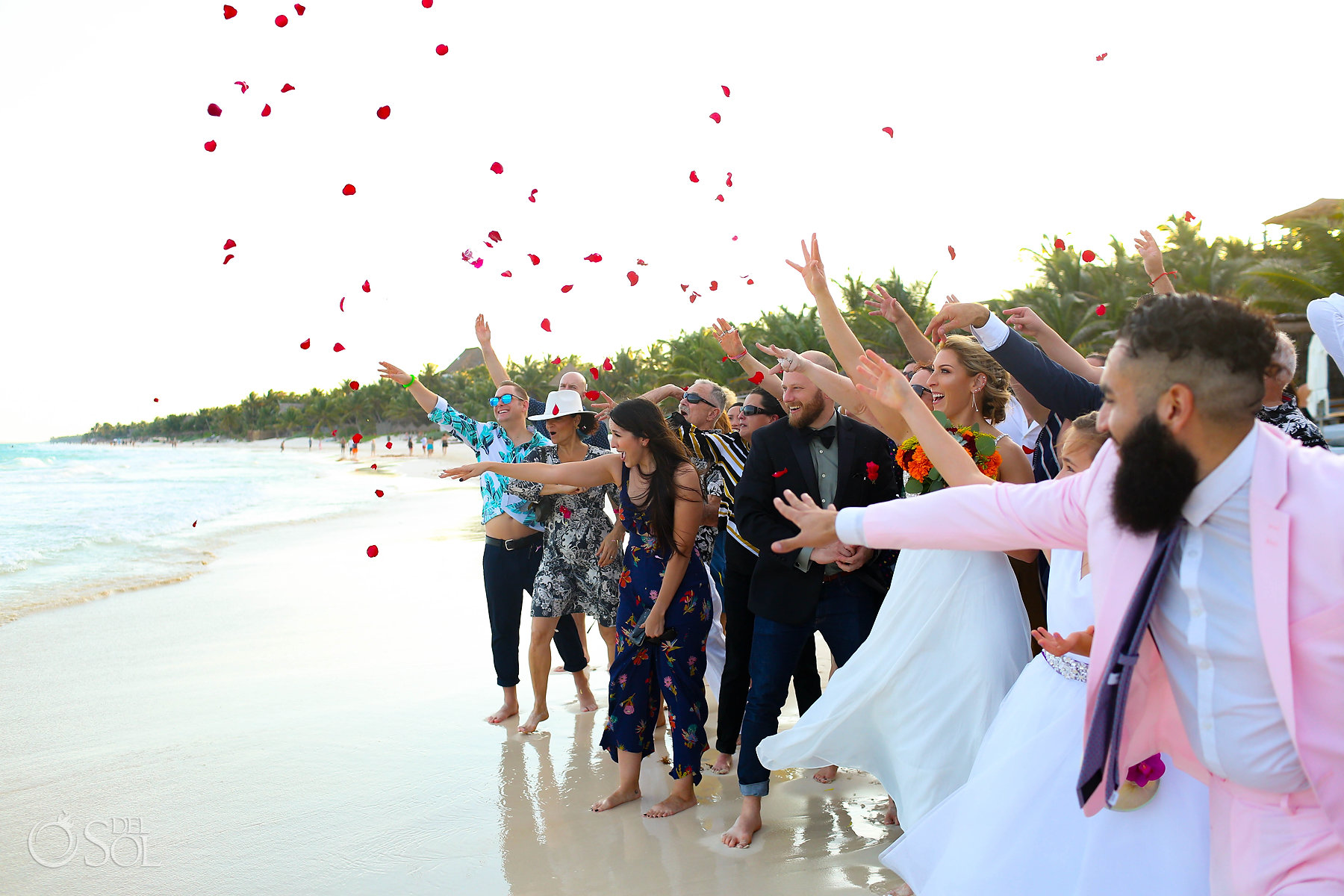 Mayan Cosmic Wedding ceremony throwing rose petals to ocean Akiin Tulum