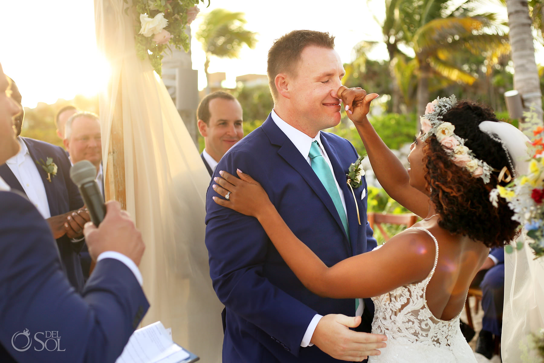 adorable wedding moment bride touches groom's nose sunset beach wedding Hotel Xcaret Mexico