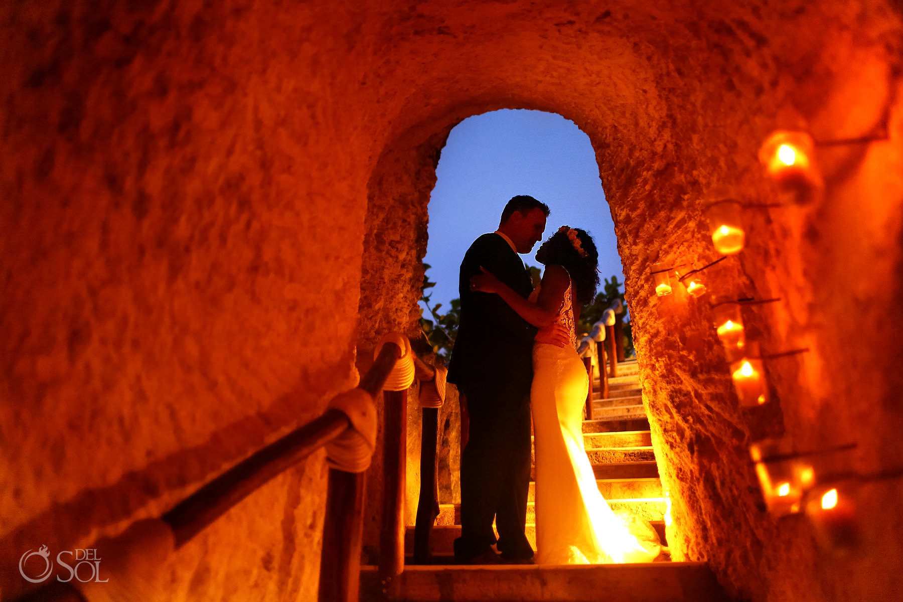 romantic wedding portrait candlelit tunnel hotel Xcaret Mexico Caleta
