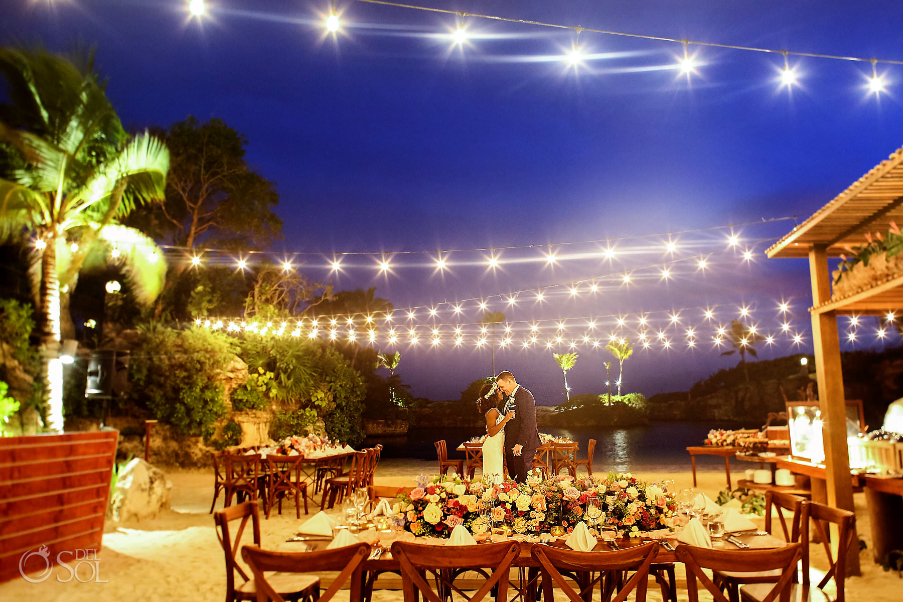 Hotel Xcaret Caleta Wedding reception setup romantic florals string lights