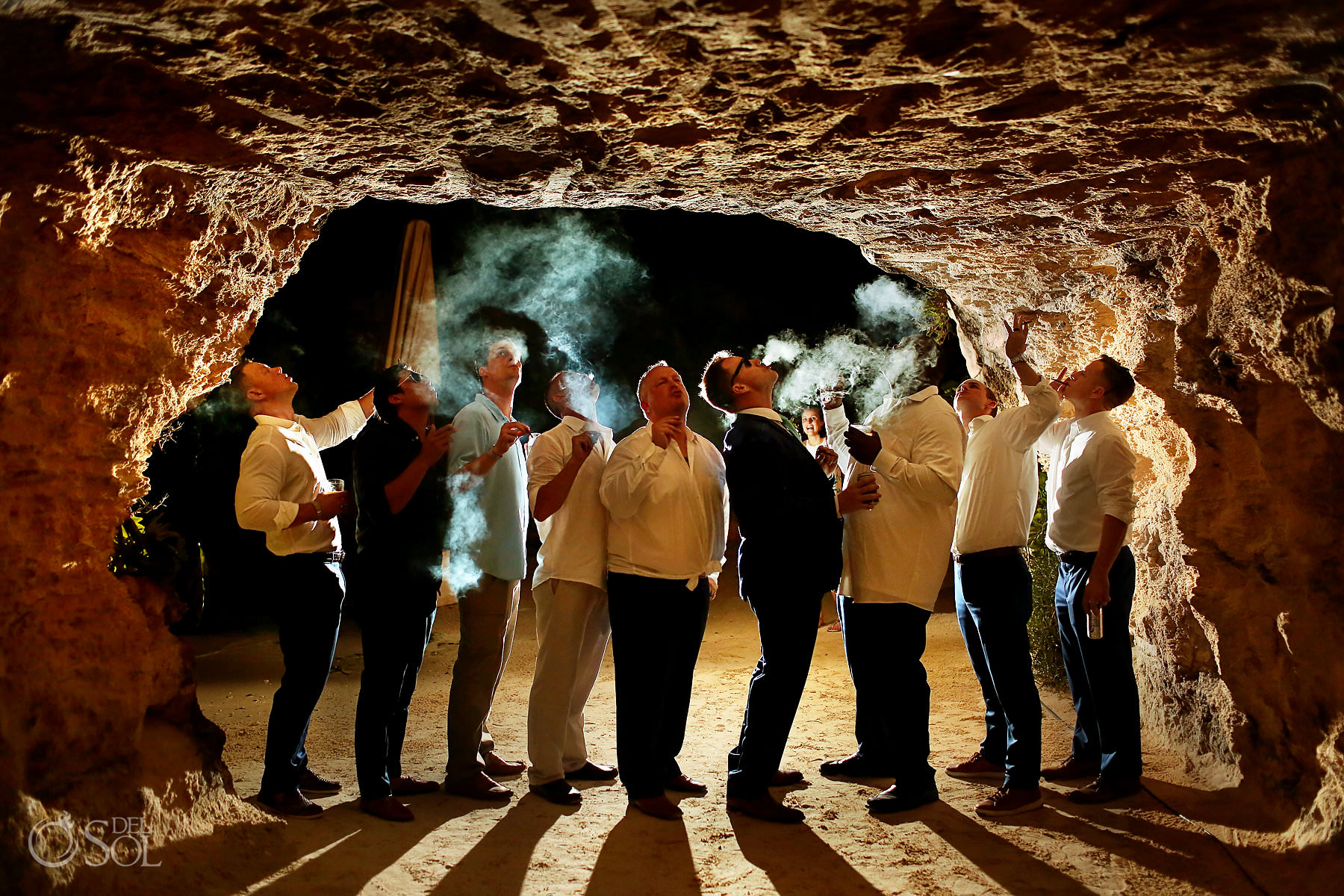 groomsment smoking cigars brif=dal party photo ideas hotel Xcaret Mexico Caleta Fuego