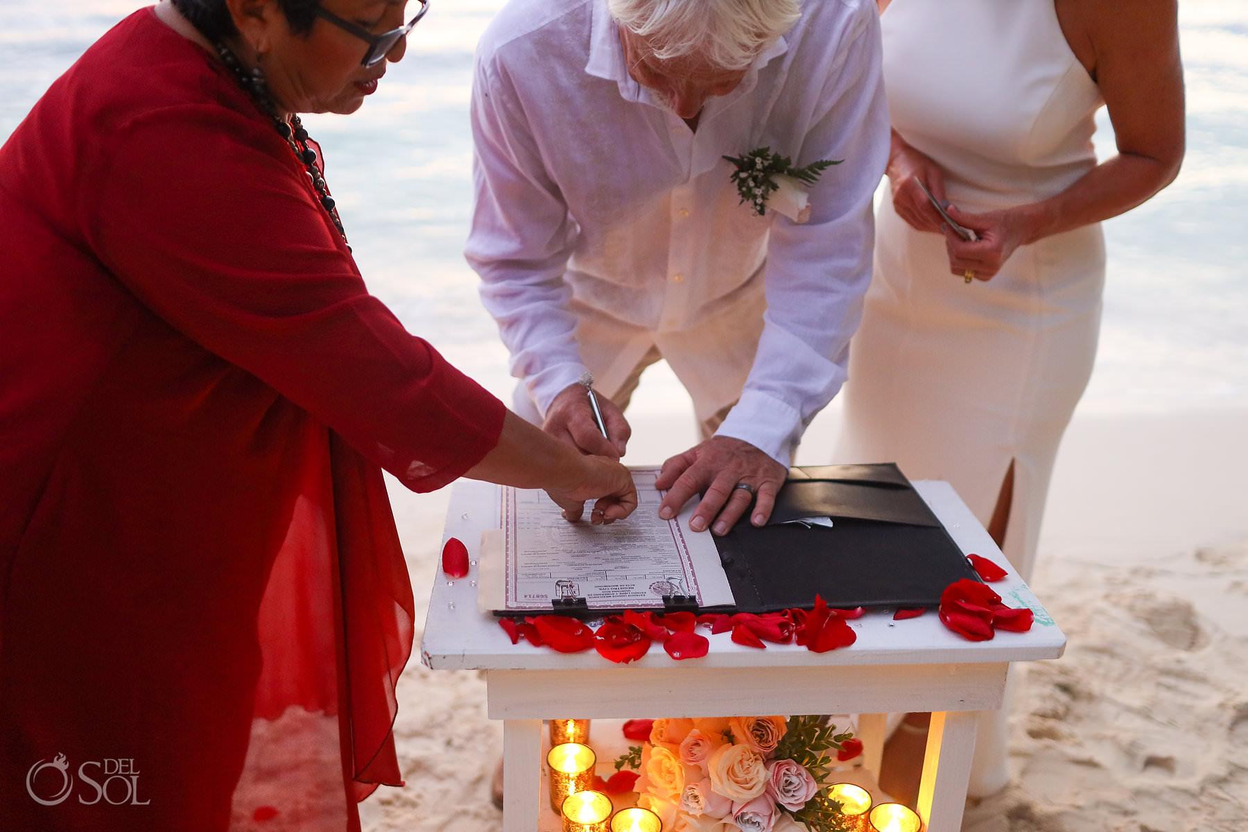 Isla Mujeres Elopement signing wedding certificate