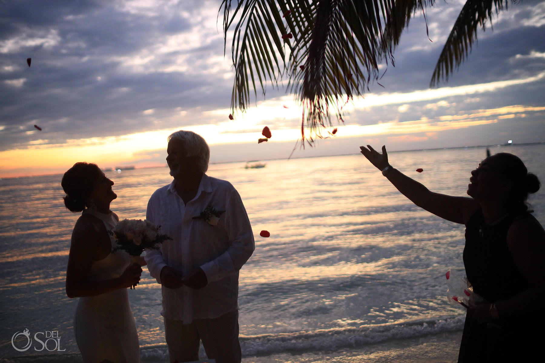 Isla Mujeres Elopement blessing with rose petals