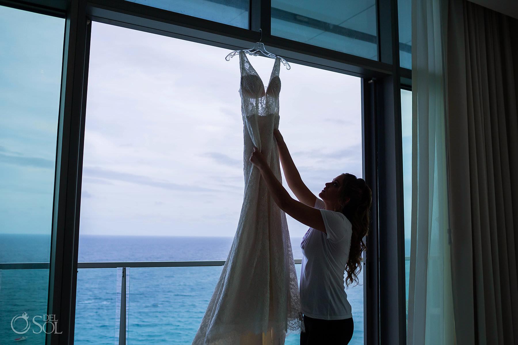 Secrets the vine balcony view bride hanging wedding dress