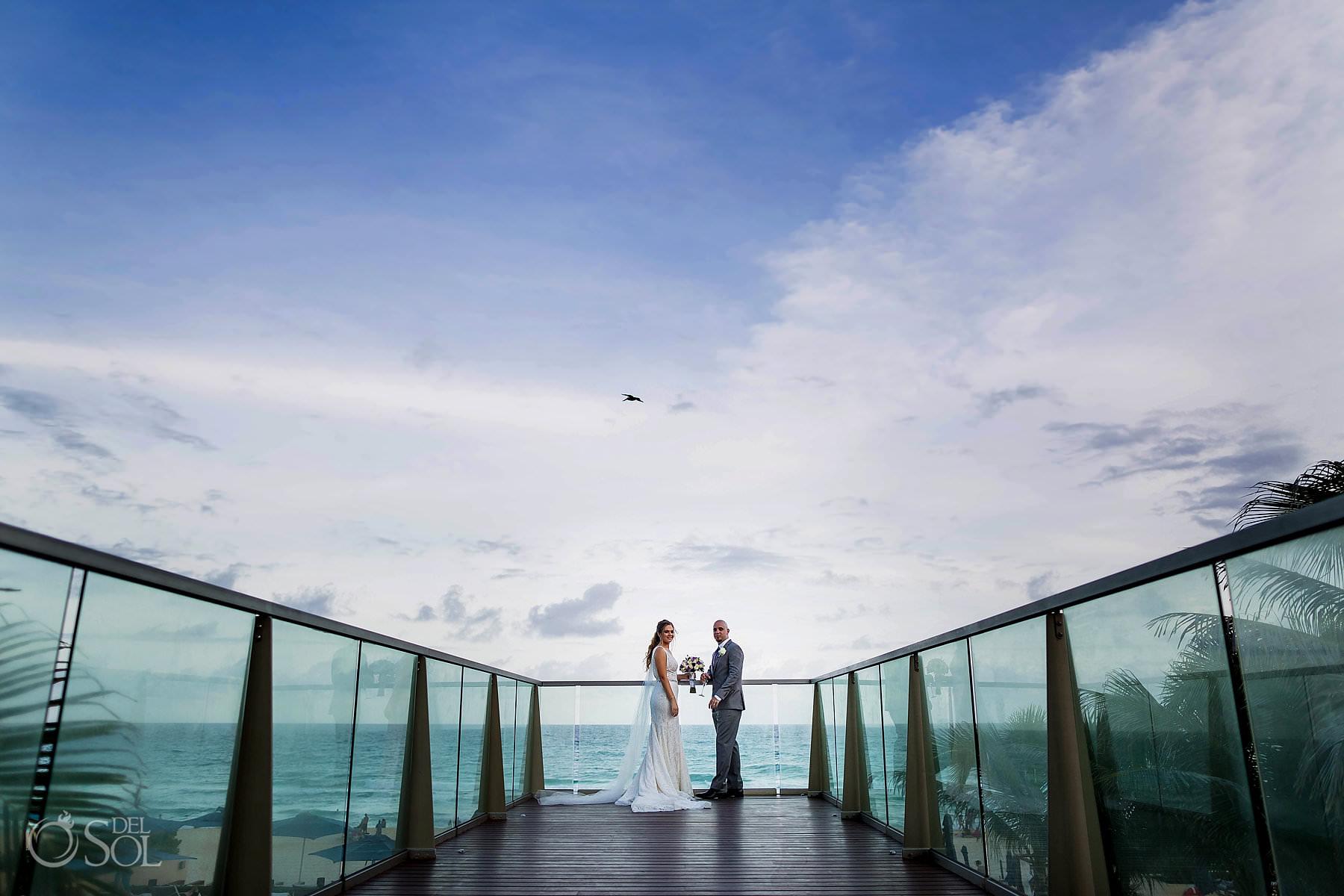 Secrets the Vine deck overlooking beach couple portrait