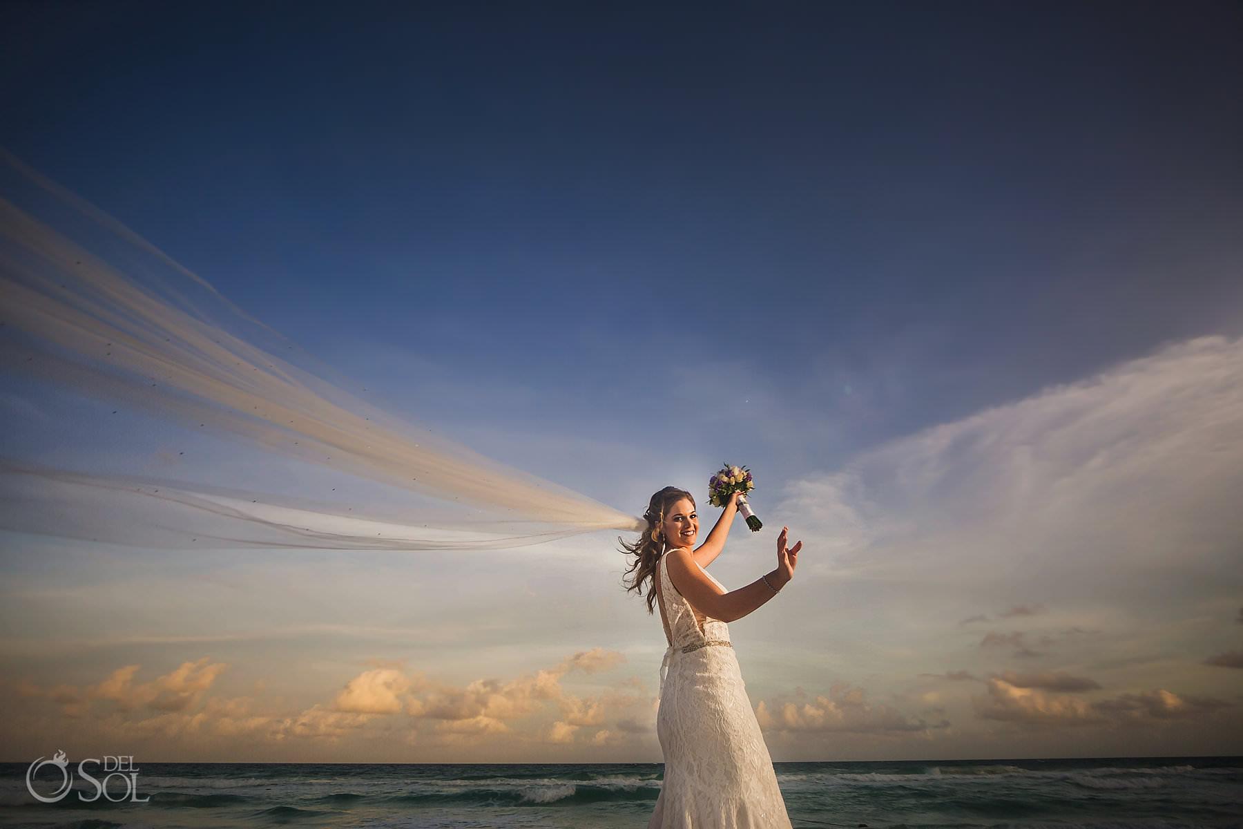 dramatic happy bridal portrait long veil