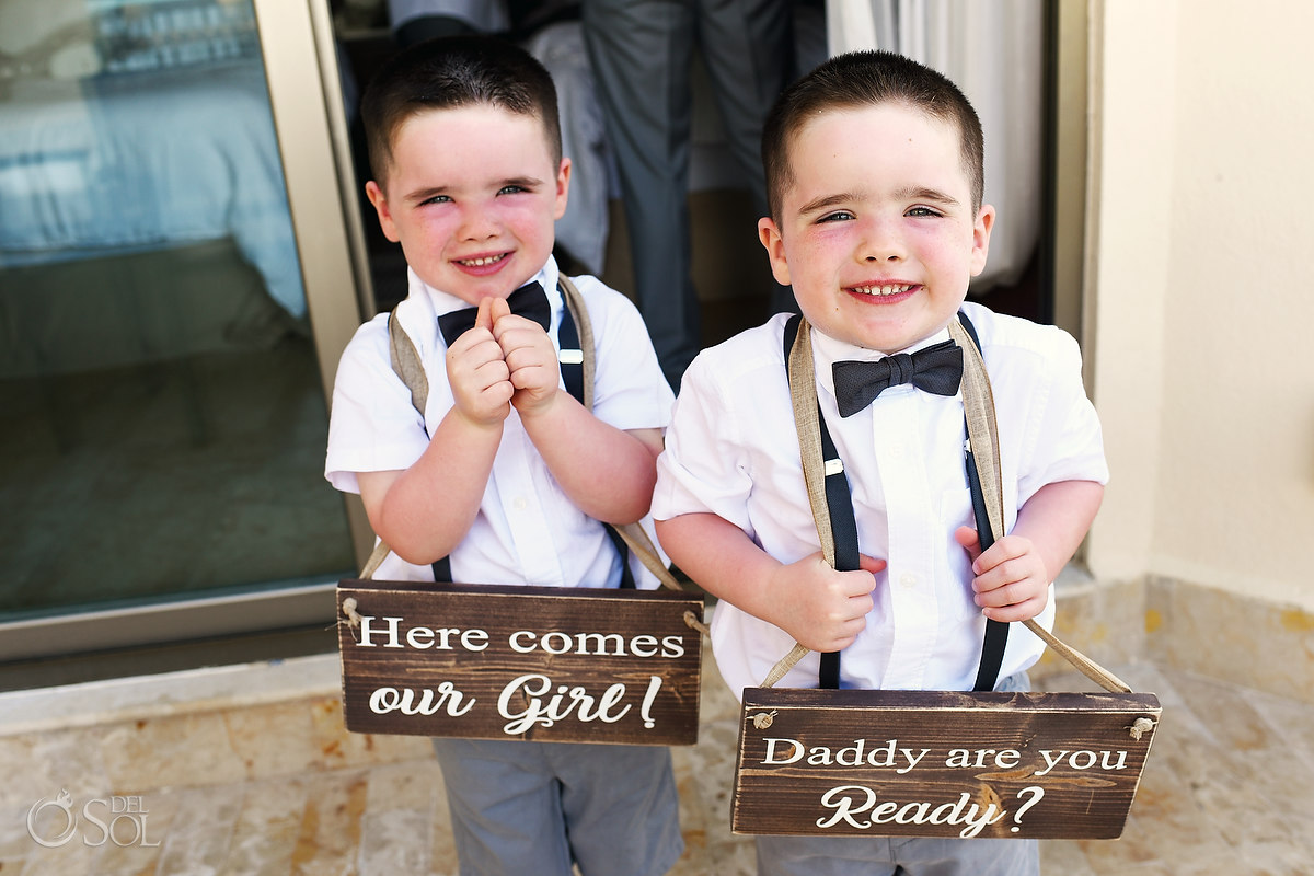 grooms children holding custom wooden wedding signs