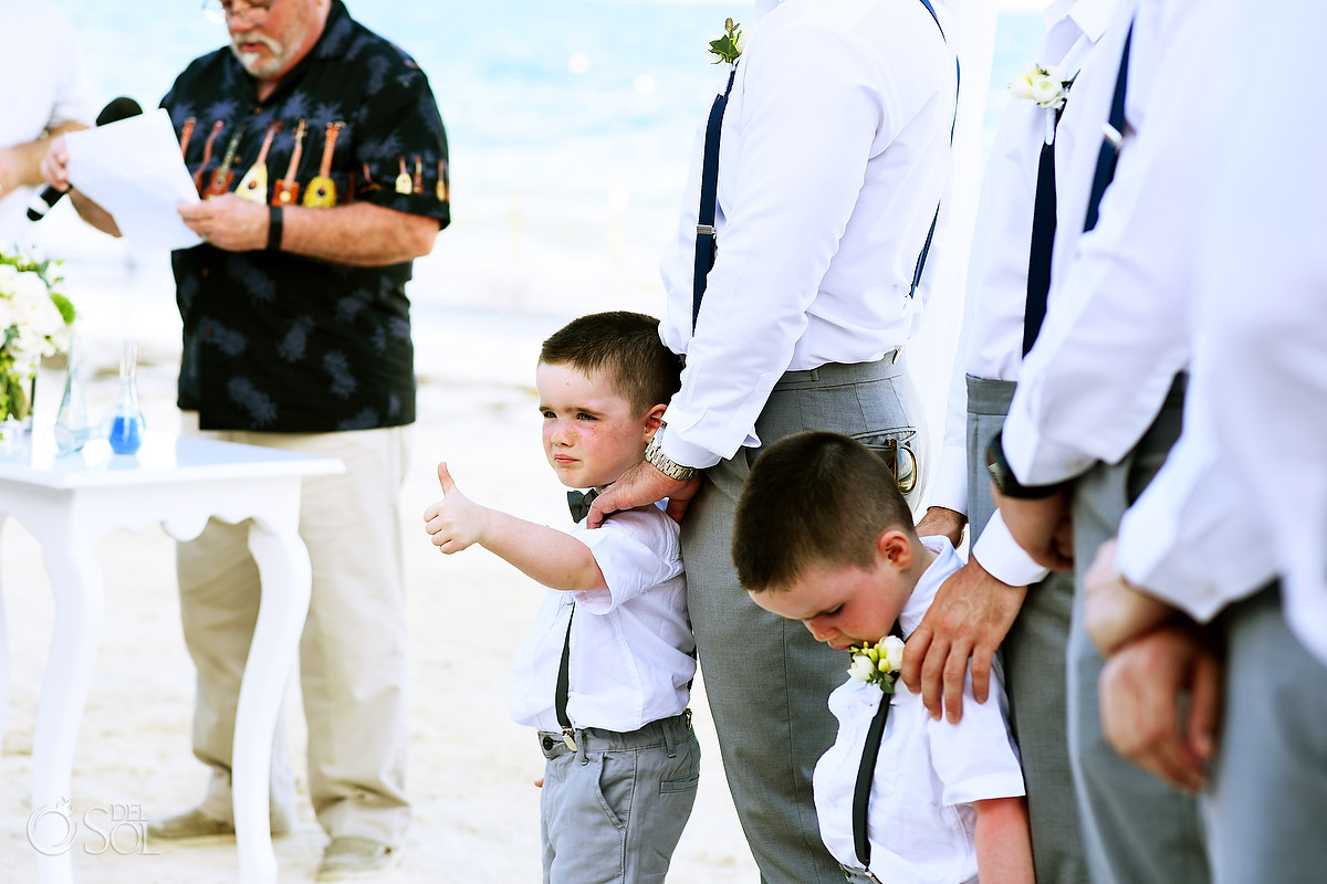 funny wedding photos ringbearer gives thumbs up