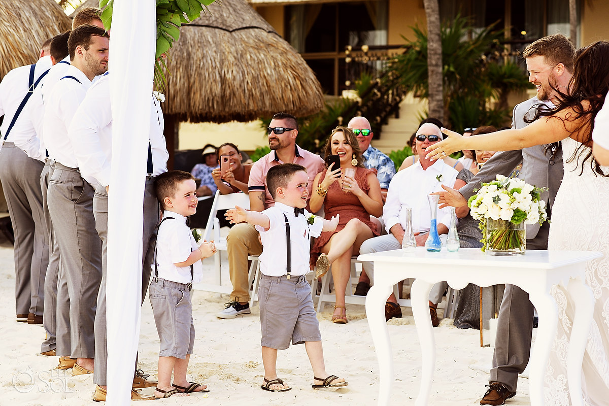 kids congratulate bride and groom Dreams Riviera Cancun Beach Wedding