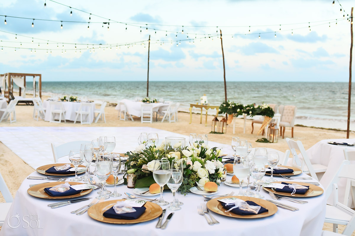 Beach wedding reception setup Dreams Riviera Cancun white contemporary chic