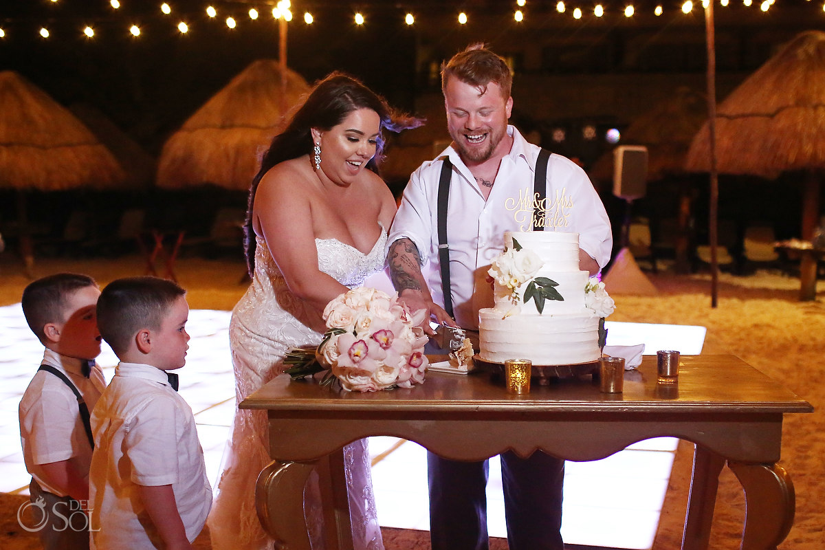 cake cutting Dreams Riviera Cancun Beach Wedding reception