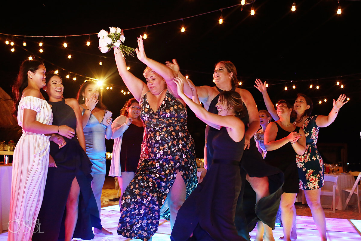 bouquet toss Dreams Riviera Cancun Beach Wedding reception