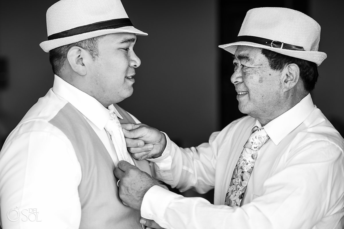 why photos are important groom and father share moment
