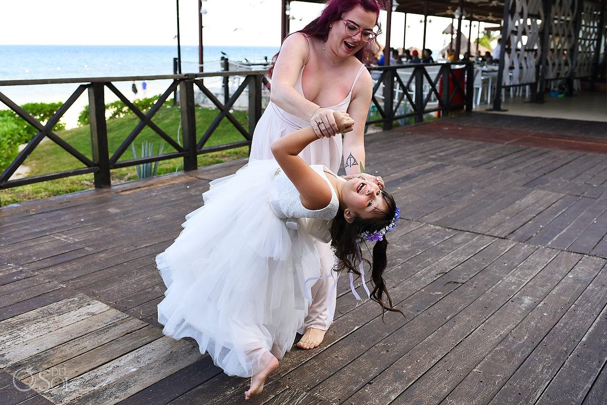 bridesmaids children of bride and groom dancing