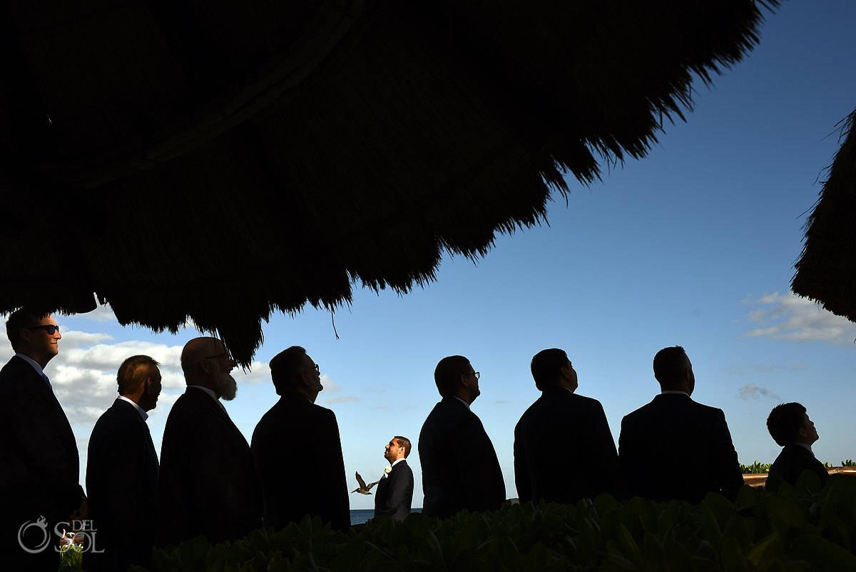 creative bridal party photo groom and groomsmen silhouettes