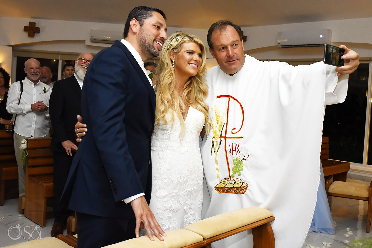 funny Catholic wedding photos priest takes selfie with newleyweds