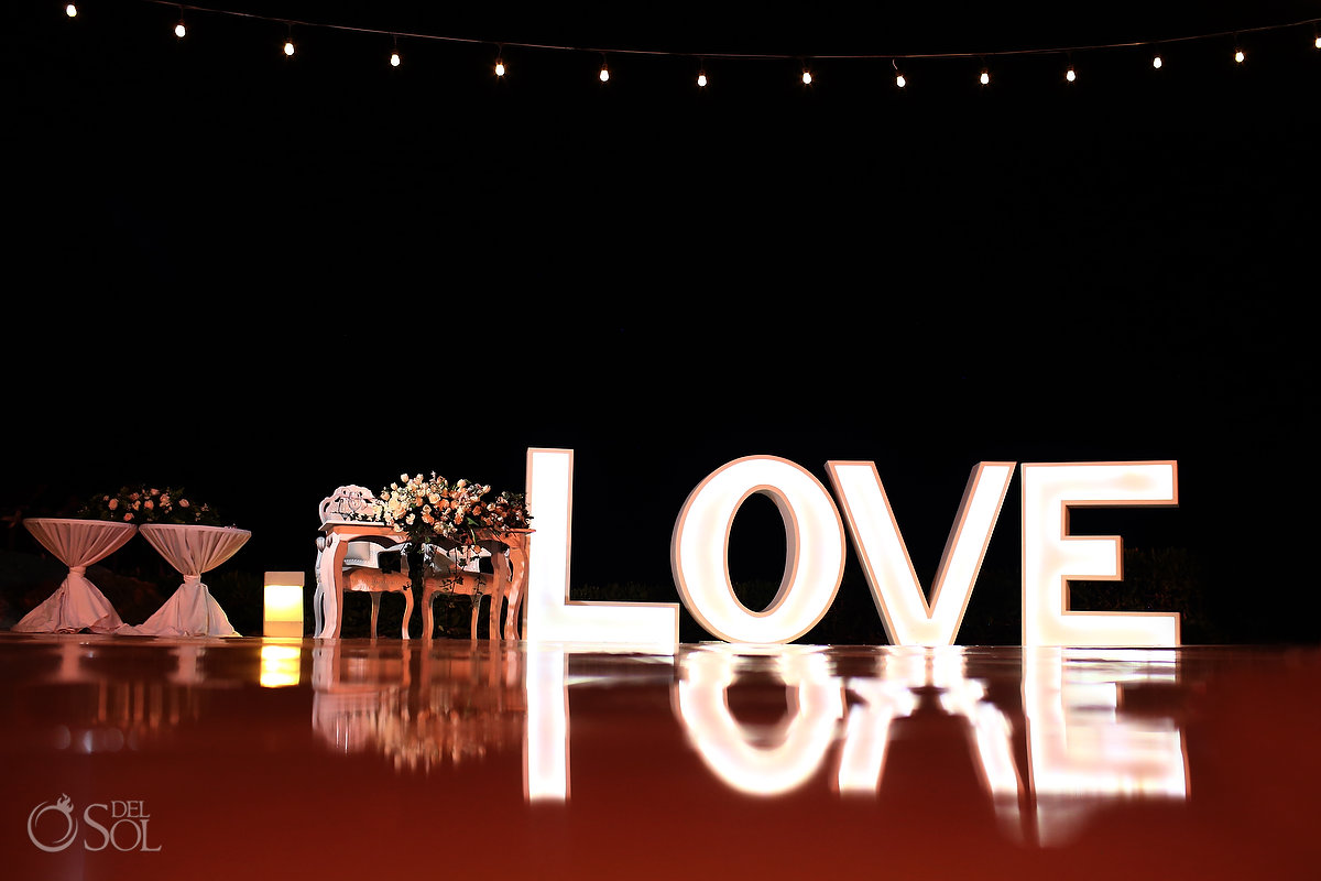wedding reception setup with LOVE sign Ocean Terrace Hard Rock Riviera Maya