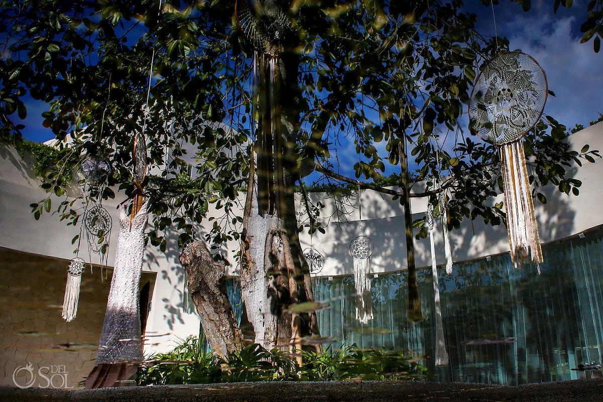 wedding dress hanging rom tree with dreamcatchers Secrets Akumal Spa