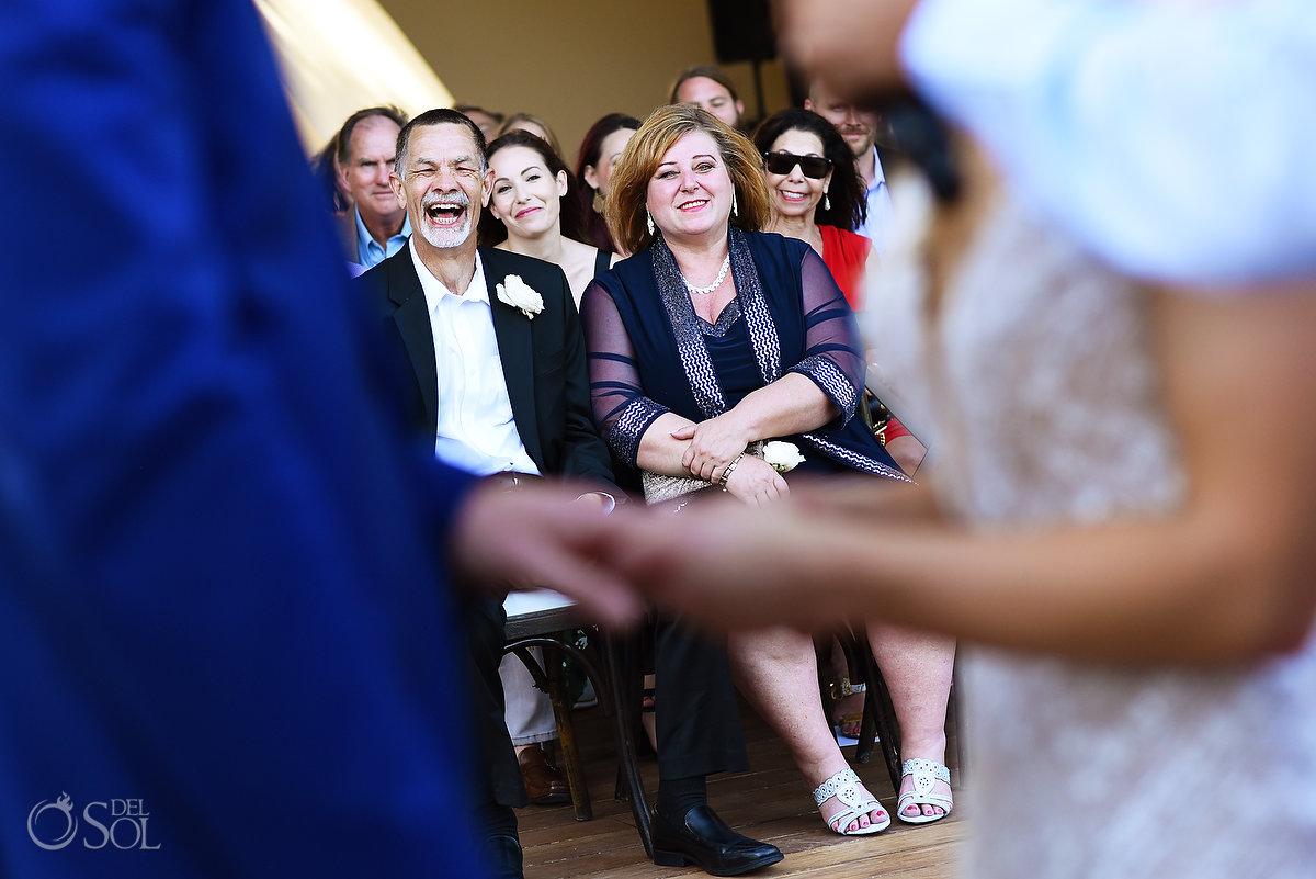 parent of bride laughing Secrets Akumal Arch Wedding Riviera Maya Mexico